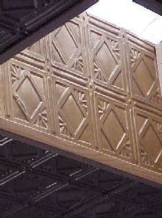 faux-tin decorative ceiling tiles in bronze